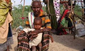 Refugee waiting for food in Horn of Africa drought crisis, water desalination plants